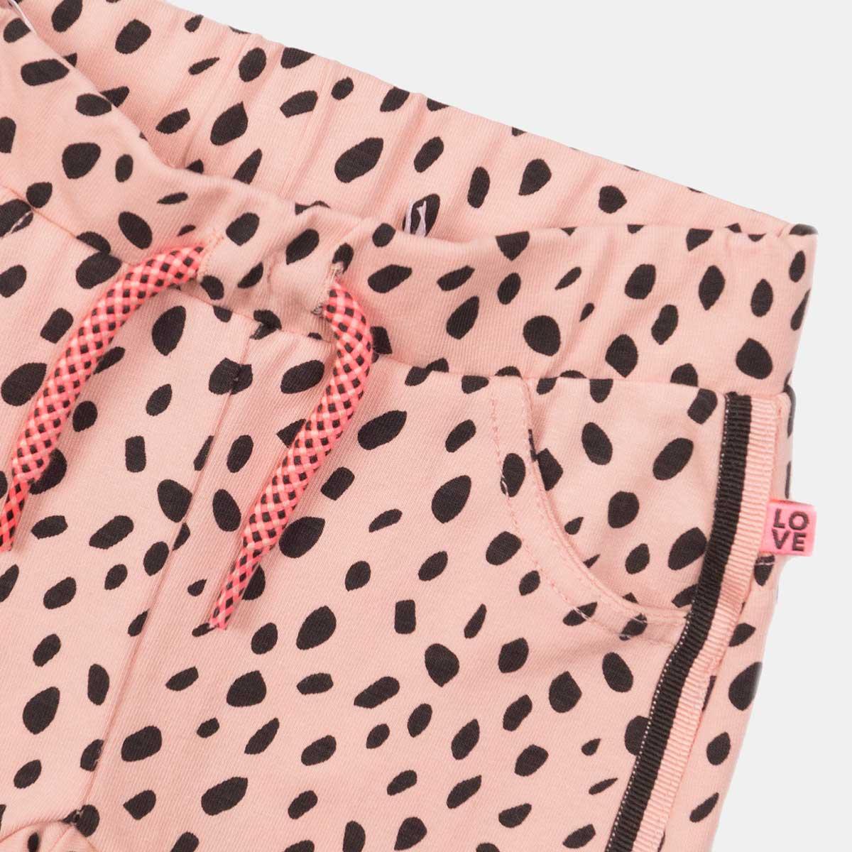 Прасковен панталон за момиче с черни точки